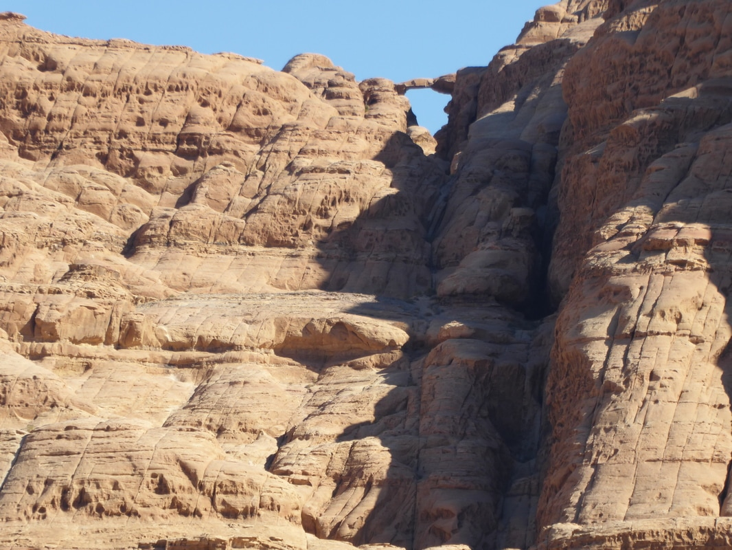 Burdah rock bridge hike Wadi Rum Real Bedouin Experience day tours sleeping under the stars